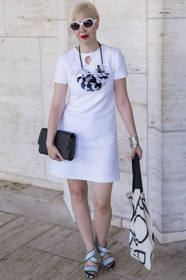 white dress with a black and white statement necklace | 40plusstyle.com