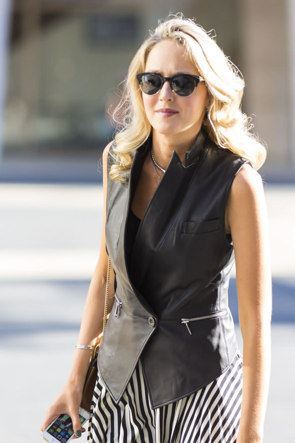 A black sleevles vest and striped skirt | 40plusstyle.com