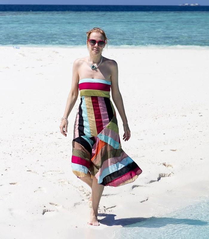 A tropical summer dress on a sandbank in the Maldives