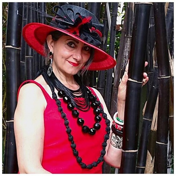 Red dress, black jewelry, red feather hat | 40plusstyle.com