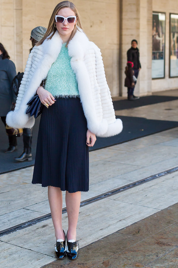 white fur cape black pleated skirt winter looks | 40plusstyle.com