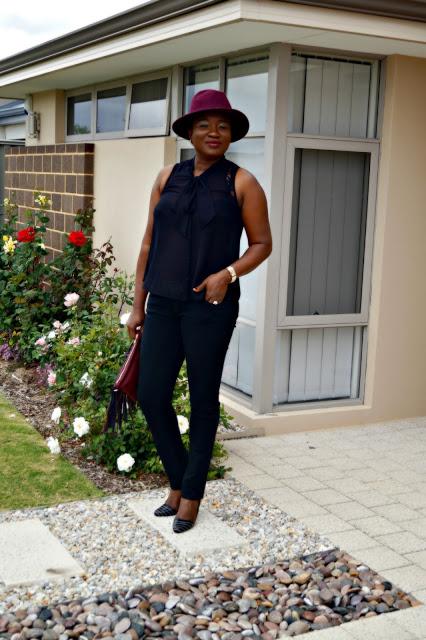 Merlot Hat Fringe Clutch Black Pants | 40plusstyle.com