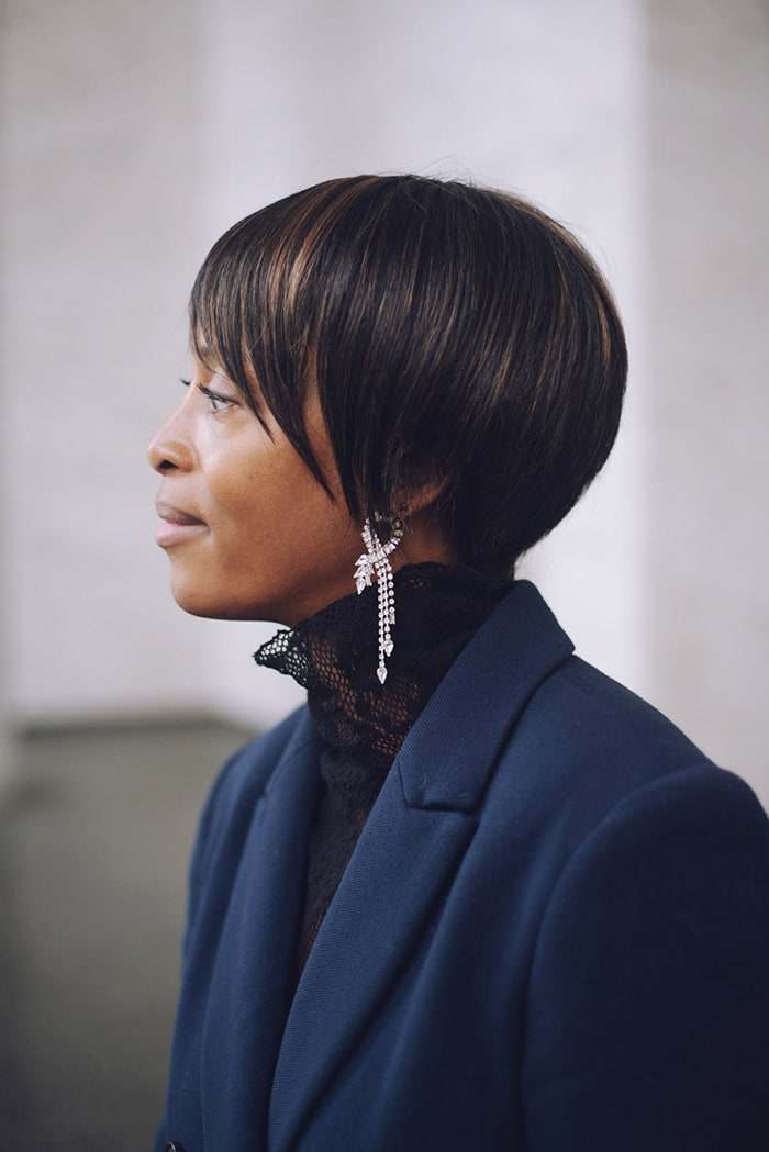 Kim wearing a lace black turtleneck | 40plusstyle.com