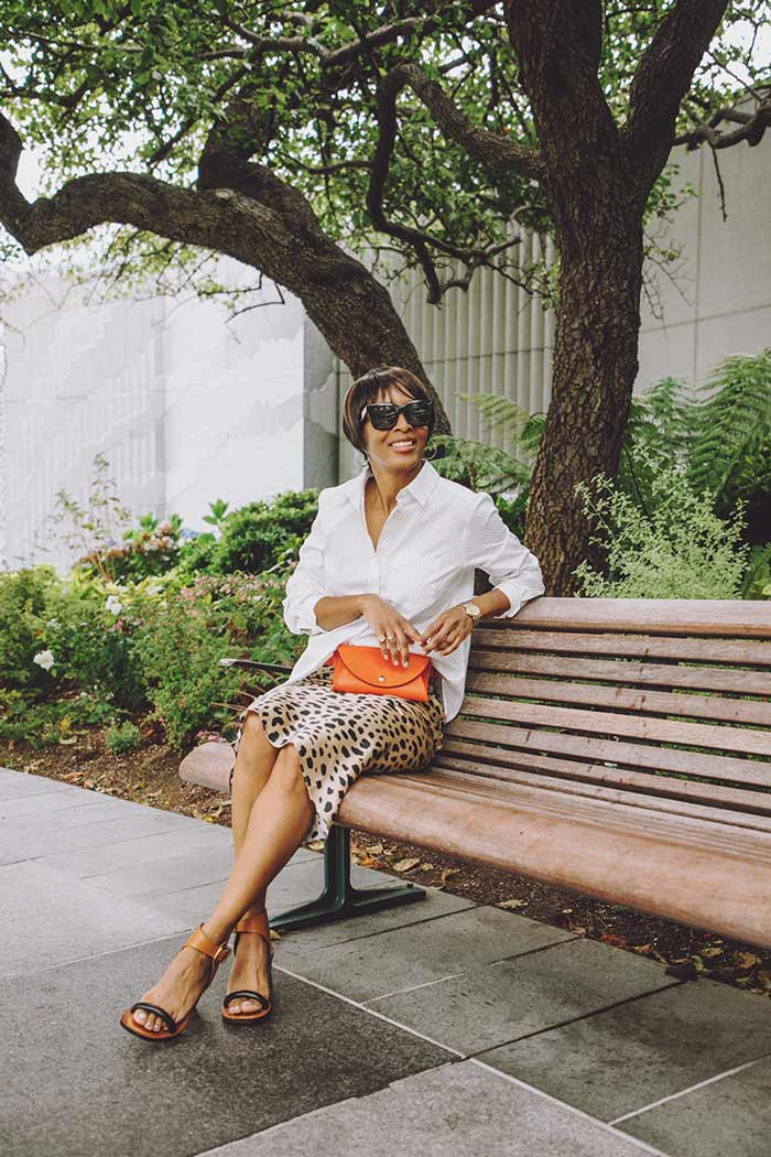 Kim wearing leopard polka dot skirt | 40plusstyle.com