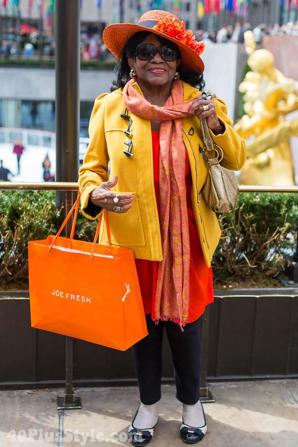 Bright yellow jacket with orange scarf   40plusstyle.com