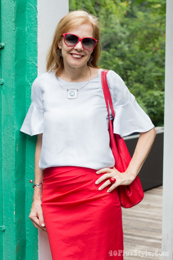 Wearing baby blue with red | 40plusstyle.com