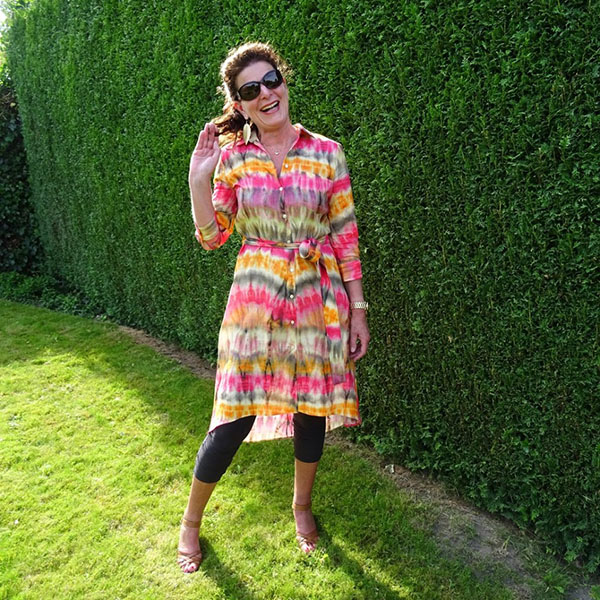 A fun and vibrant tie dye dress outfit   40plusstyle.com