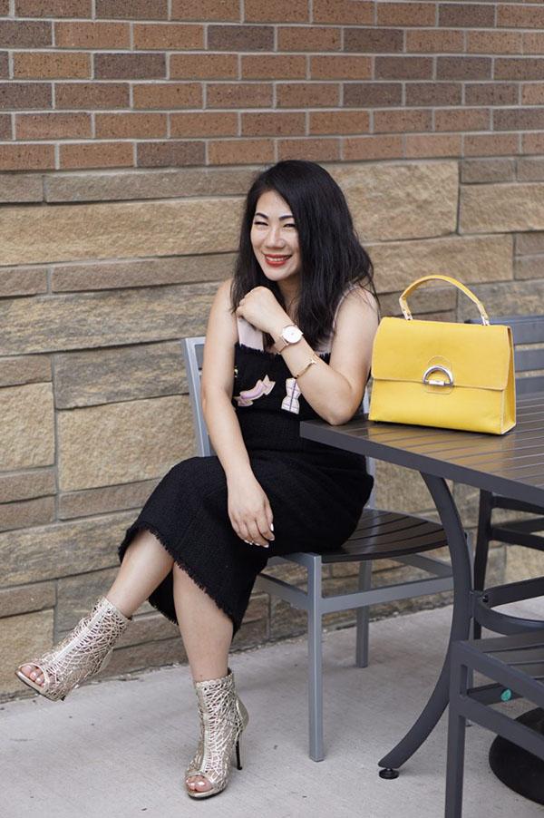 Black Moschino dress and yellow satchel | 40plusstyle.com