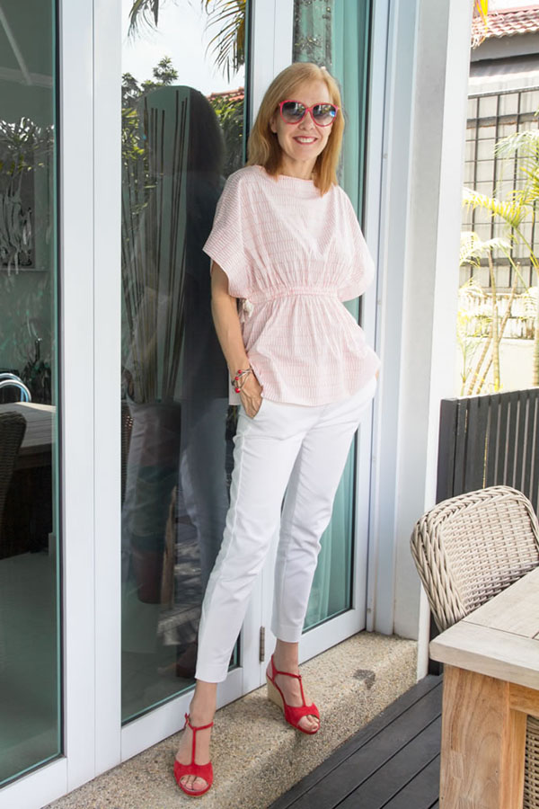 Capsule wardrobe items: skinny pants and a beautifully draped top   40plusstyle.com