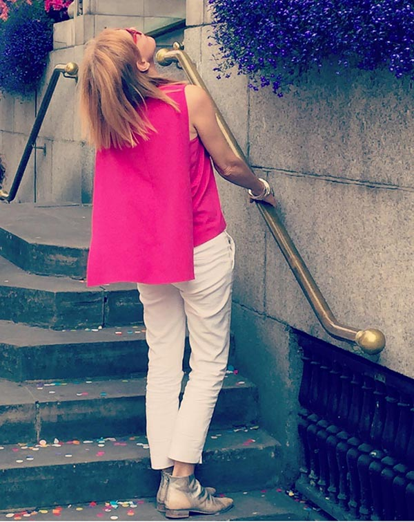 Style idea: Pink capelet top with skinny 7/8 pants   40plusstyle.com