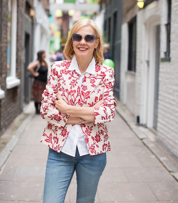 A flower jacket and jeans | 40plusstyle.com