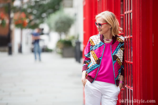 Street style London: Pink top and white pants with chic accessories   40plusstyle.com