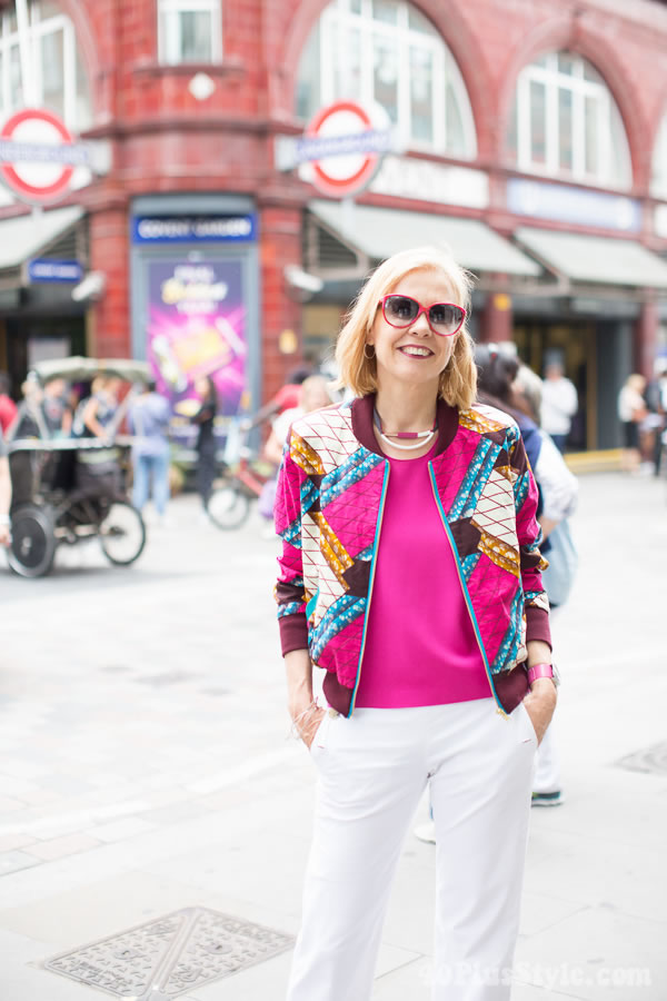 Vibrant and stylish outfit: Pink and printed bomber jacket   40plusstyle.com
