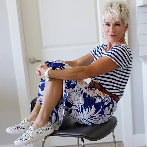 Shauna wearing striped top and floral skirt   40plusstyle.com