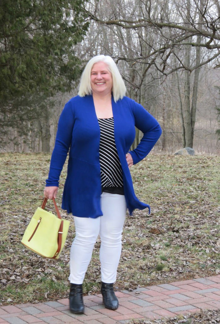 Julia wearing blue cardigan, striped top and white jeans   40plusstyle.com