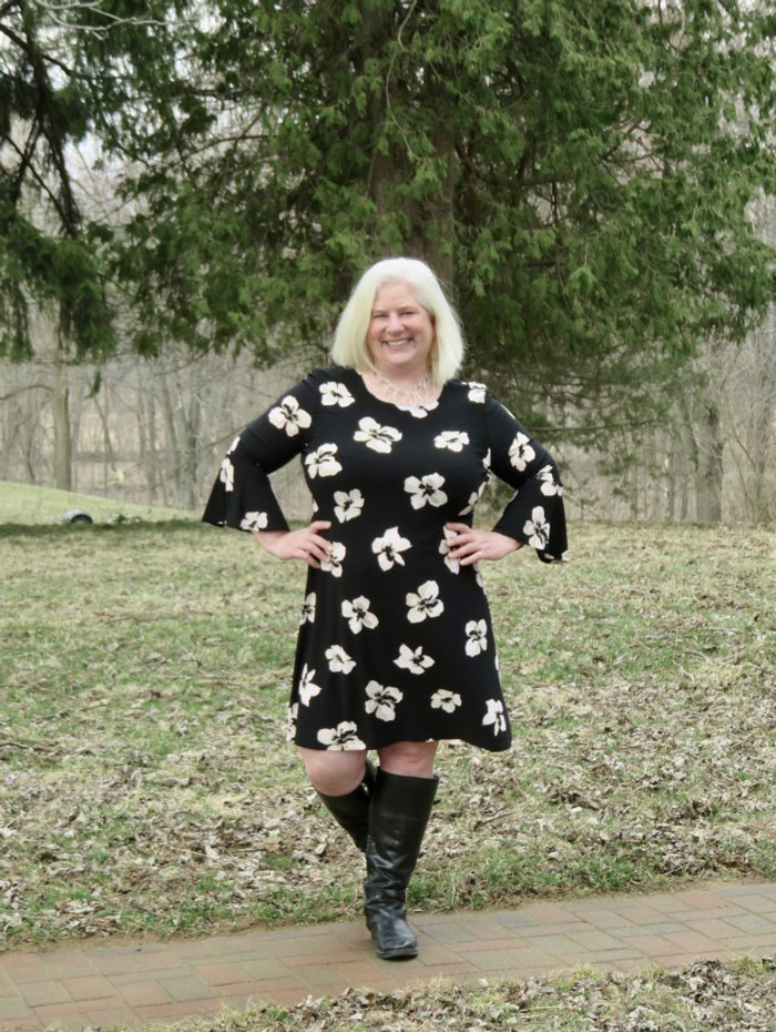 Julia wearing floral dress and boots   40plusstyle.com