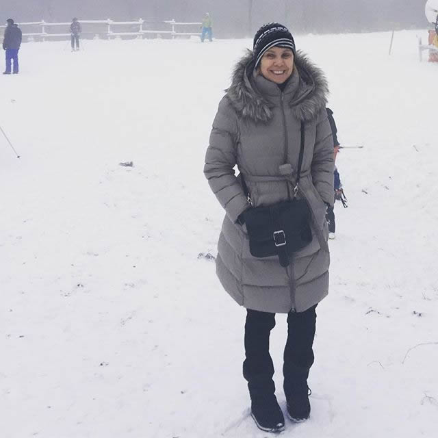 A long down coat for winter (here worn in Winterberg, Germany) | 40plusstyle.com
