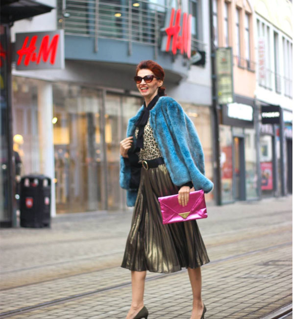 Fluffy coat and a pleated skirt | 40plusstyle.com