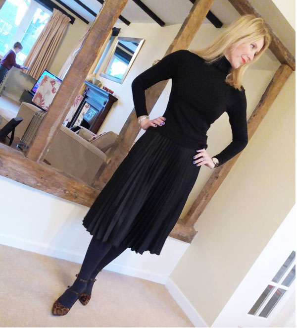 black turtleneck with a skirt outfit idea | 40plusstyle.com