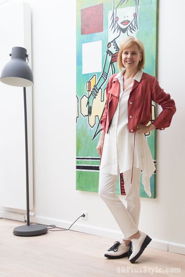 Sylvia wearing a red jacket and white outfit | 40plusstyle.com
