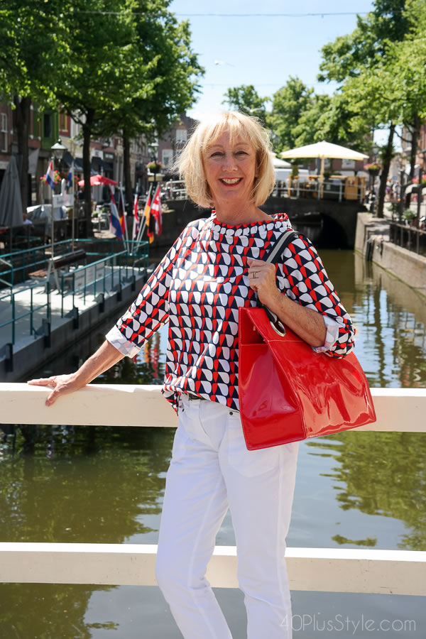 Bold colors paired with pants white outfit by Greetje | 40plusstyle.com