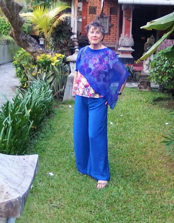 How to wear a blue asymmetrical poncho | 40plusstyle.com
