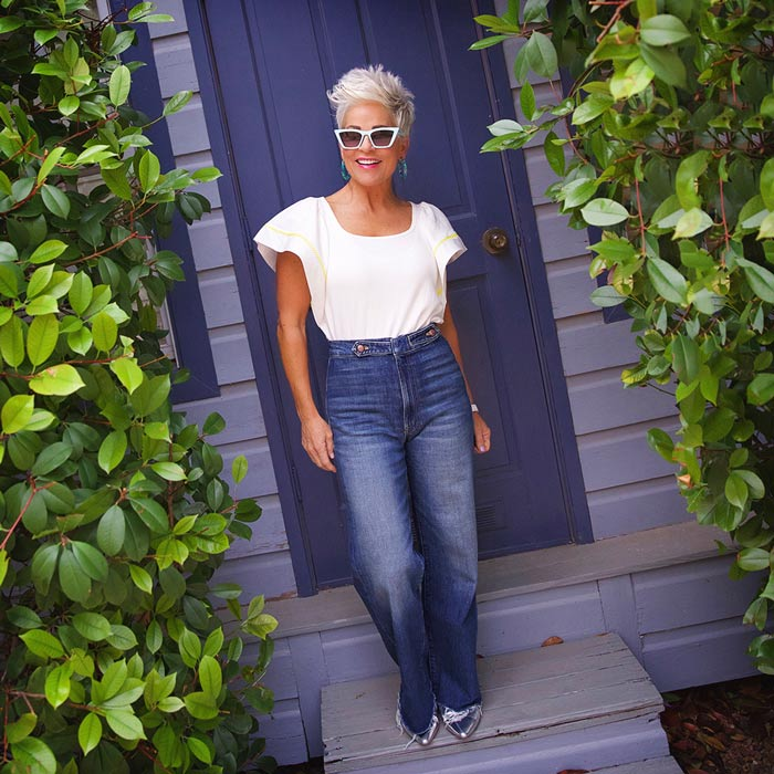 Shauna wearing flounce sleeve top and jeans   40plusstyle.com