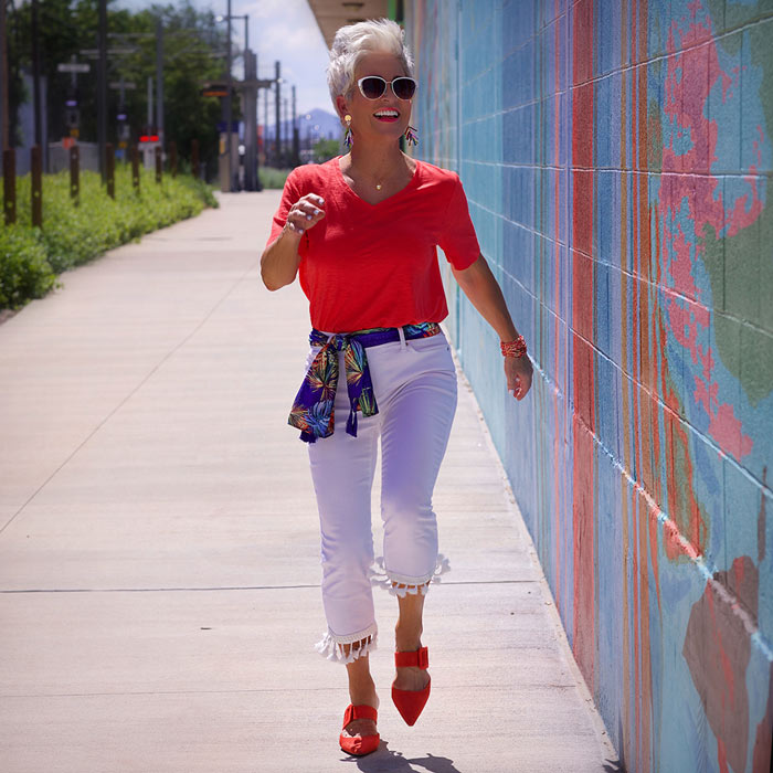 Shauna wearing red tee and white jeans | 40plusstyle.com