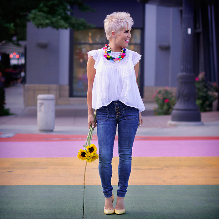 Shauna wearing white flounce top and jeans   40plusstyle.com