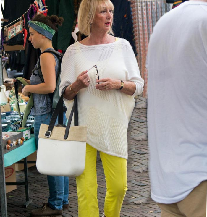 Asymmetric top with yellow pants   40plusstyle.com