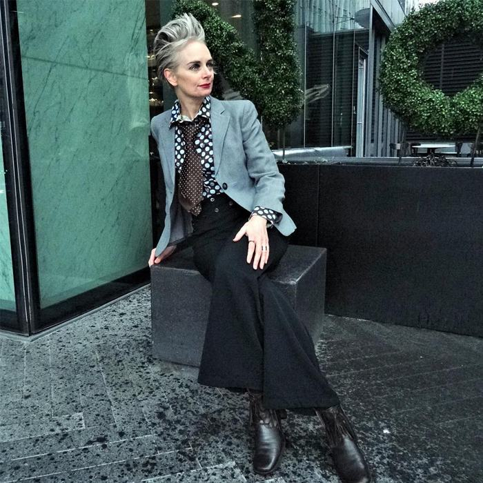 Melanie is wearing Polka Dot blouse over gray blazer and wide leg black pants   fashion over 40   40plusstyle