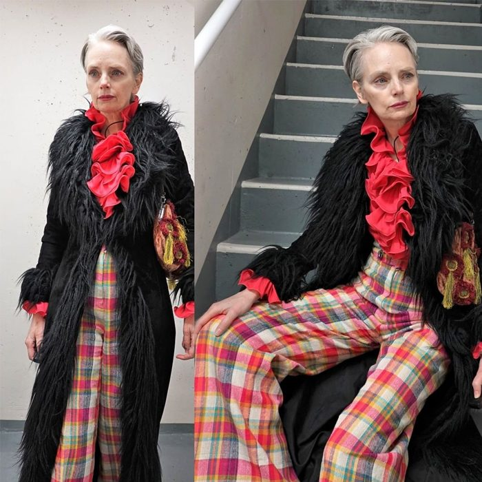 Melanie is wearing Red ruffles over black long coat with plaid pants   fashion over 40   40plusstyle
