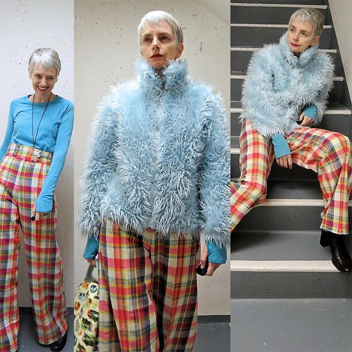 Melanie is wearing blue turtleneck sweatshirt over powder blue faux fur jacket and striped plaid pants | fashion over 40 | 40plusstyle