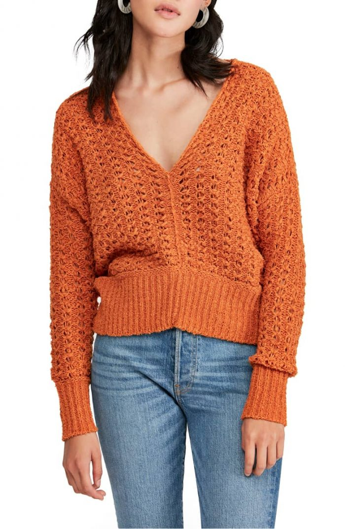 wearing an orange sweater with jeans   40plusstyle.com