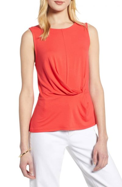 wearing an orange top with white jeans   40plusstyle.com