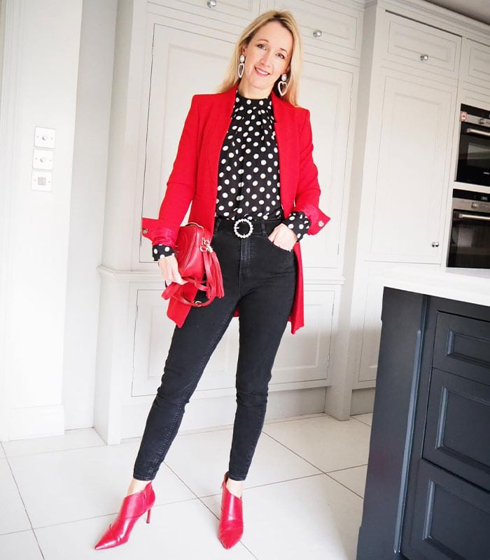 Work outfit idea: polka dot print top, long red coat, skinny jean and booties | 40plusstyle.com