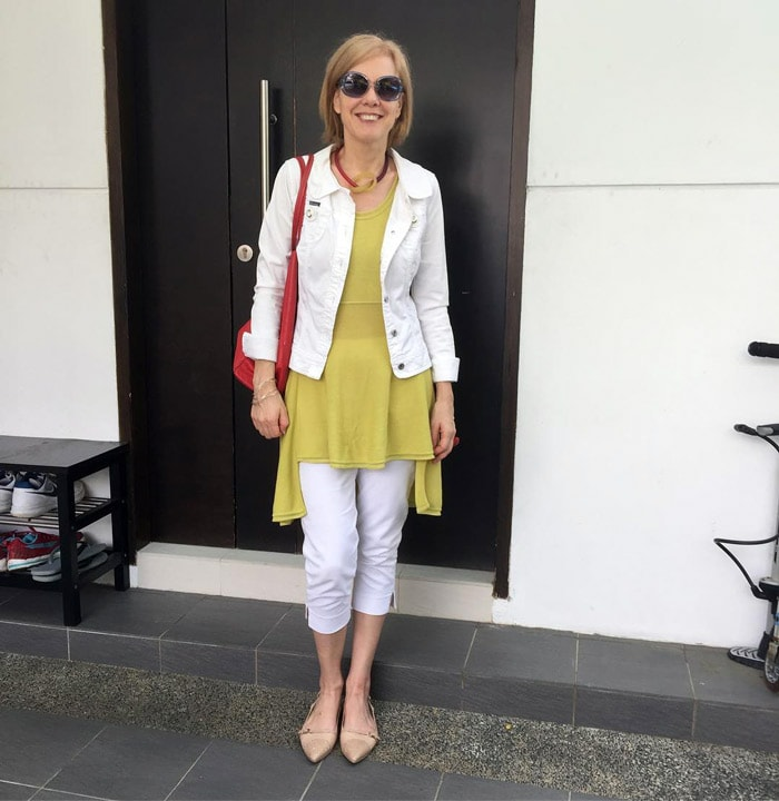 White jacket, yellow top and white pants | 40plusstyle.com