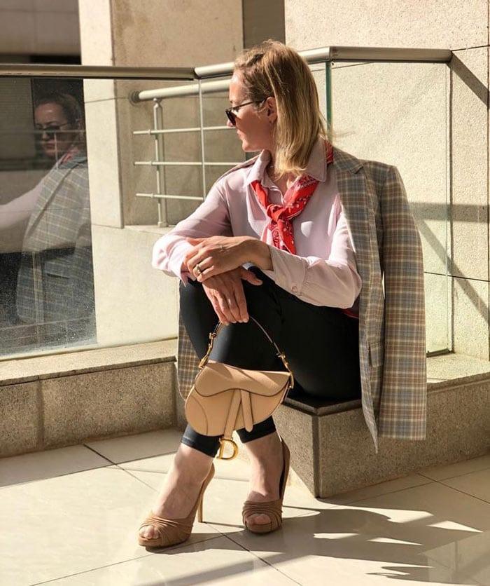 Divina wearing plaid coat, jeans, designer bag and pumps | 40plusstyyle.com