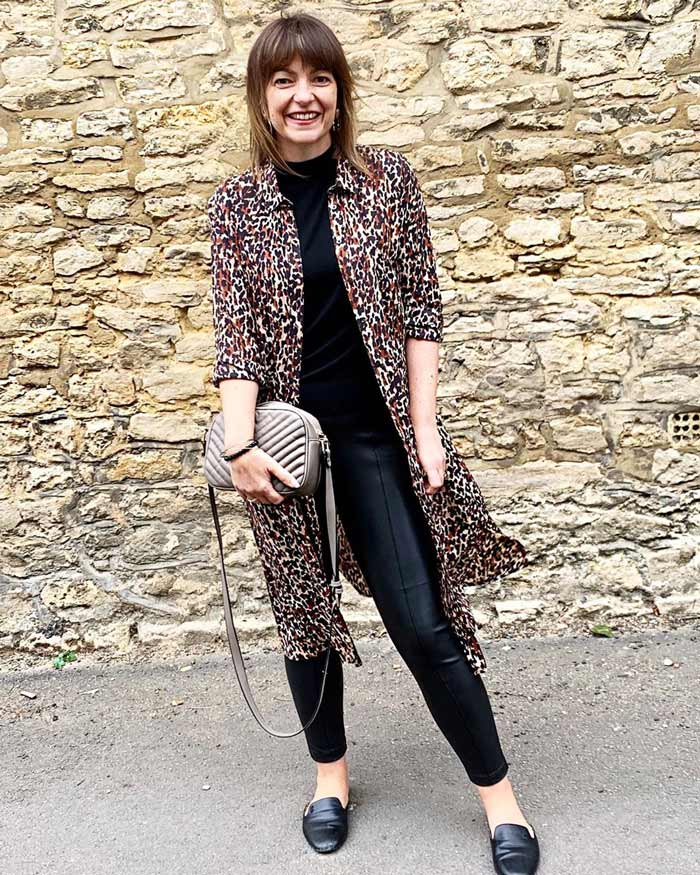Lizzi wearing a leopard print topper with mock tee, leather leggings and loafers   40plusstyle.com