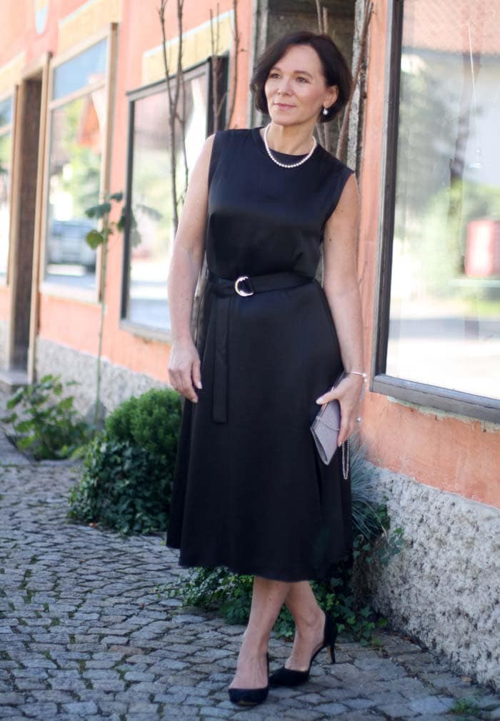 A classic black midi dress for evening wear | 40plusstyle.com