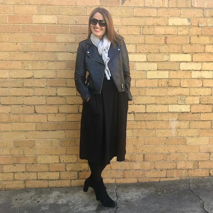 Wearing a midi dress with moto jacket and booties | 40plusstyle.com