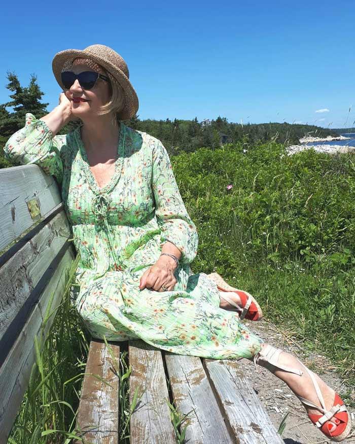 Terri wearing a floral summer dress | 40plusstyle.com