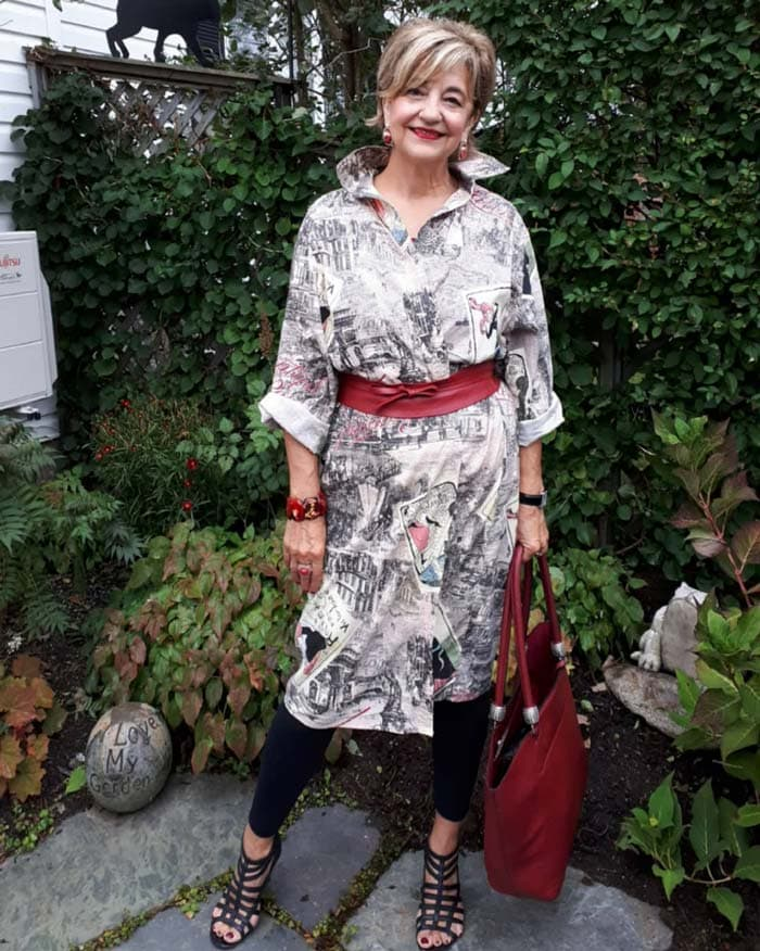 Terrie wearing a printed dress over legging with a belt | 40plusstyle.com
