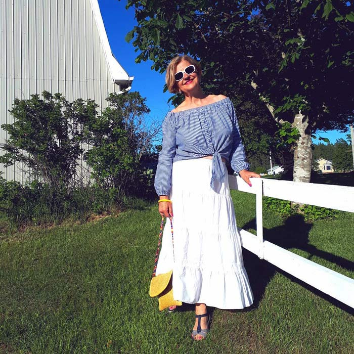 Terrie wearing an off shoulder blouse and maxi skirt | 40plusstyle.com