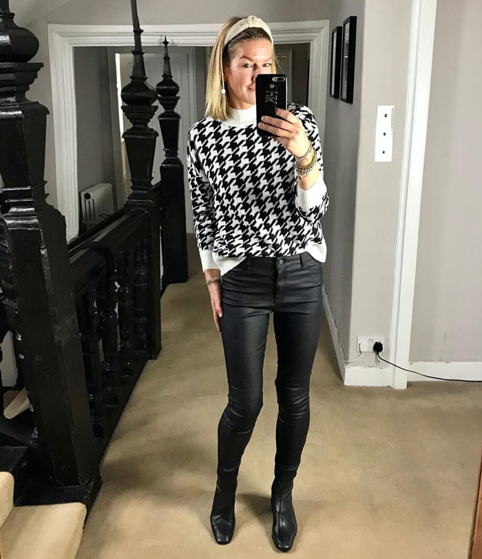 Hayley wearing a houndstooth print sweater with faux leather pants and booties | 40plusstyle.com