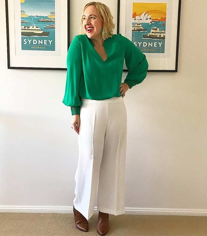 Kylie wearing a v-neck blouse and wide leg pants | 40plusstyle.com