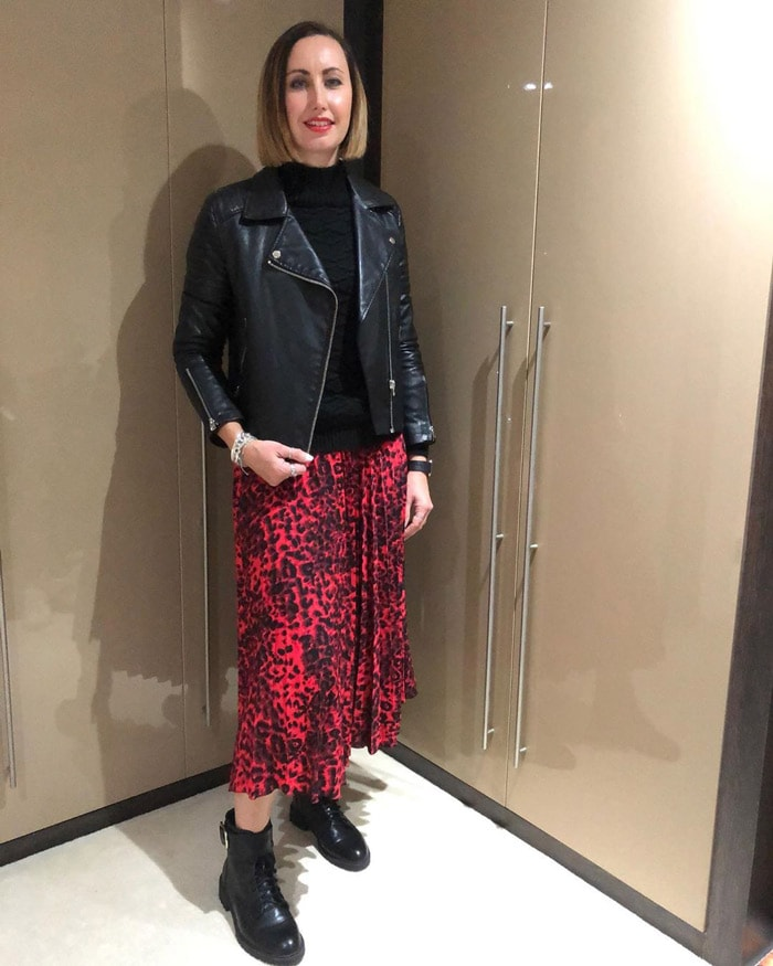 leather jacket worn with sweater, skirt and boots   40plusstyle.com