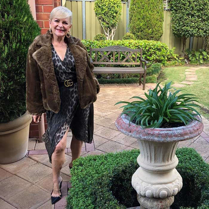 Holiday party outfit idea: faux fur jacket over a dress   40plusstyle.com