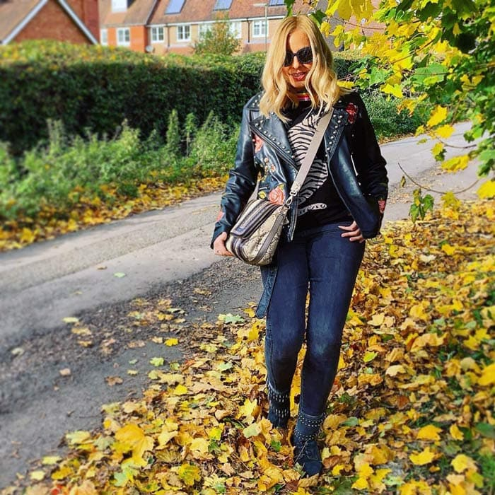 leather jacket worn with sweater, denim leggings and boots   40plusstyle.com
