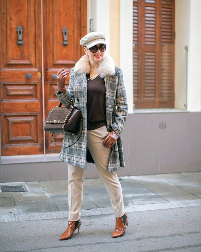 Patricia wearing a plaid coat with leather gloves | 40plusstyle.com
